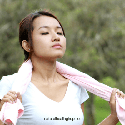 Lady taking in deep breaths and looking very calm and peaceful. Post about Deep Breathing Exercises to feel better quickly.