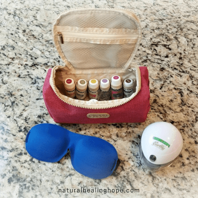 Essential Oil Storage for Home and for Travel- picture of a bag organizing oils, diffuser and eye mask