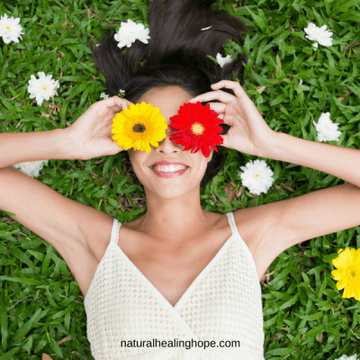 Happiness Challenge: Girl with flowers on your eyes looking very happy