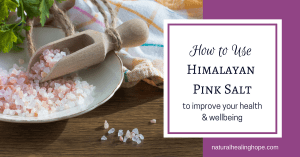 A plate of pink salt with a scooper and text overlay that says: How to use himalayan pink salt to improve your health
