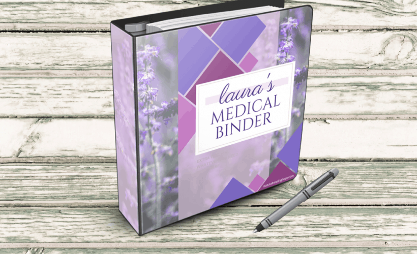 Image of Laura's Medical Binder with a pen