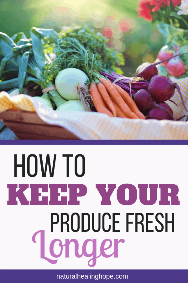 Picture of fresh vegetables in a basket with text overlay that says: How to keep your produce fresh longer