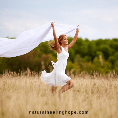 Lady running through a field joyfully- How to Choose Joy Even When Live is Hard