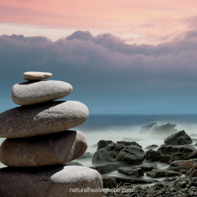 Balanced rocks on the ocean with a new dawn. Weight Watchers has a new Wellness Plan and why I am giving it another try