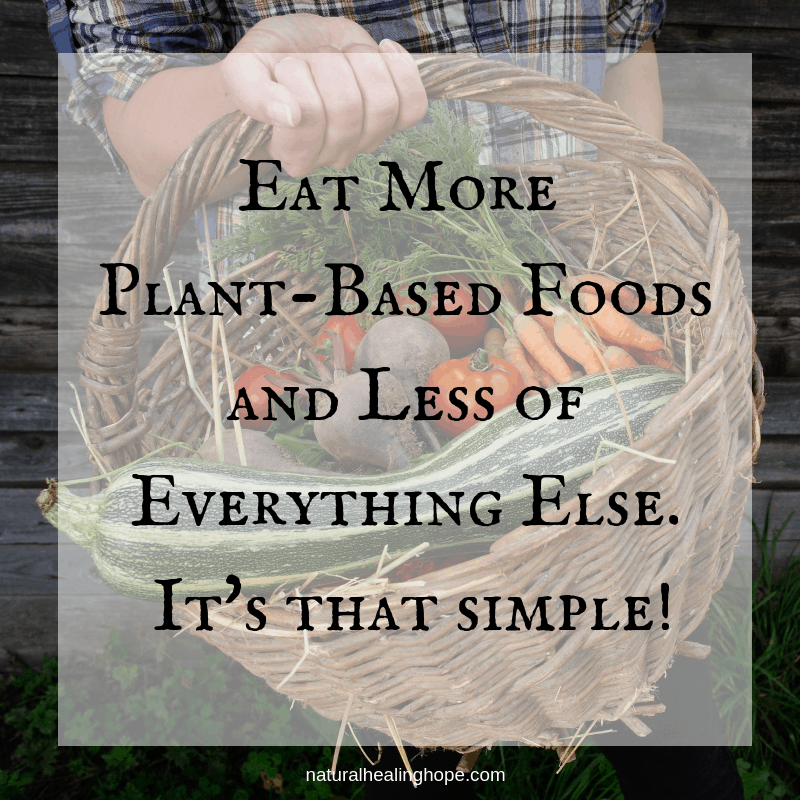 Someone holding basket of vegetables with text overlay that says: Eat more plant-based foods and less of everything else. It's that simple!