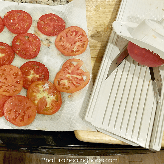 slicing tomatoes for rustic heirloom tomato galette