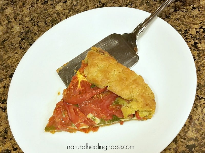 A serving of rustic heirloom tomato galette (gluten-free)